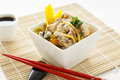 Sesame chicken noodle salad a with chopsticks and soy sauce Stock Image