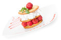 Sesame pastry with strawberries whipped cream and Royalty Free Stock Image