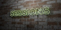 SESSIONS - Glowing Neon Sign on stonework wall - 3D rendered royalty free stock illustration