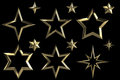 Set of 12 golden stars Stock Images