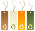 Set of 4 tags with recycling icons Stock Images