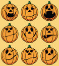 Set of 9 smiley pumpkin faces Royalty Free Stock Photo