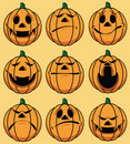 Set of 9 smiley pumpkin faces Royalty Free Stock Image