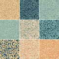 Set of abstract seamless backgrounds with curls in retro colors Stock Photography