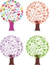 Set abstract trees seasonal colors treetop made different objects flowers animals ellipse Royalty Free Stock Image