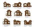 Set of apartment house icons in brown and white showing different styles building in silhouette Royalty Free Stock Images