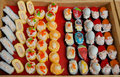 Set of appetizers and sushi on display of fast-food shop Royalty Free Stock Photo