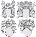 Set of aristocratic emblems no vector image four medieval coats arms executed in woodcut style isolated on white background blends Royalty Free Stock Photos