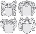 Set of aristocratic emblems no vector image four medieval coats arms executed in woodcut style isolated on white background blends Stock Photography