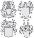 Set of aristocratic emblems no vector image four medieval coats arms executed in woodcut style isolated on white background blends Royalty Free Stock Photography