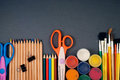 Set of art tools multiple in a row on a gray background Royalty Free Stock Photography