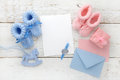 Set of baby girl and boy booties and greeting card form. Top view Royalty Free Stock Photo