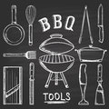 Set of barbecue tools drawn in chalk on a blackboard. Hot brazier, grater to peel, blender, frying pan, tongs, knife, slicer. Royalty Free Stock Photo