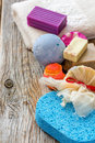 Set for a bath towels soap scrub aromatic bomb on wooden board Royalty Free Stock Image