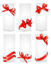 Set of beautiful cards with red gift bows Royalty Free Stock Photos