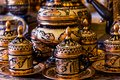 Set of beautiful coffee cups and pots with golden traditional eastern ornaments Royalty Free Stock Photo