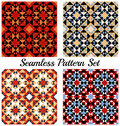 Set of 4 beautiful geometric patterns with triangles and squares of red, orange, blue, white, black and beige shades Royalty Free Stock Photo
