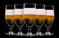 Set of beer glasses on black background