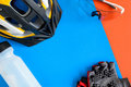 set bicycle equipment on a blue and orange paper background