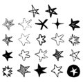 Set of black hand drawn vector stars in doodle style on white background