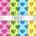 Set of Blue, Green, Pink, Yellow Seamless Patterns of Hand-drawn Hearts.