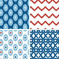Set of blue and red ikat geometric seamless vector patterns backgrounds with hand drawn elements Royalty Free Stock Photo