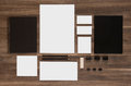Set of branding mockup on brown wooden desk Royalty Free Stock Photo