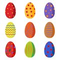 A set of bright colorful Easter eggs decorated with flowers, circles, stripes, waves.