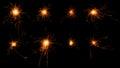 Set Of Burning Sparklers On Bl...