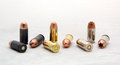 Set of cal acp bullets russian made fmj us made fmj and hollow point caliber Royalty Free Stock Photo