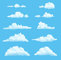 Set of cartoon clouds on blue. vector