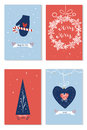 Set of christmas cards with wishes, new year tree, giftboxes holiday decoration over blue and red backround. Royalty Free Stock Photo