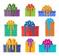 Set of christmas gifts boxes in holiday packages with colored bowknots. Christmas presents designed in flat style.