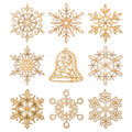 Set of Christmas snowflakes and  hand bell shape decoration made wood Royalty Free Stock Photo