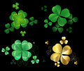 Set of clover green and gold leaves with three and four leaves on a black background Stock Photo