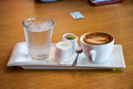 A set of coffee with glass water Stock Images