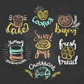 Set of color bakery logos on the chalkboard bakery labels Royalty Free Stock Photo