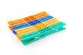 Set color clothes pegs over white Royalty Free Stock Photo