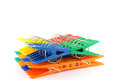 Set color clothes pegs over white Royalty Free Stock Image