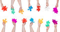 Set of color puzzle pieces in people hands Royalty Free Stock Photo