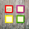 Set of color wooden frames on wood desk background. Royalty Free Stock Photo