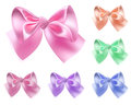 Set of colored bows six made silk ribbons Royalty Free Stock Photos
