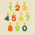 Set of colored glossy birthday cake candles isolated on bright background with fire flame Royalty Free Stock Images