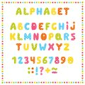Set of colored letters and numbers. Childrens alphabet. Font for kids. Bright colors, pink, blue, green, yellow on white backgroun