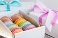 Set of colorful macaroon and gift boxes with ribbon and bow Royalty Free Stock Photo