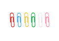 Set of colorful paperclips on a white background Royalty Free Stock Images