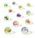 Set of colorful realistic glass toy marbles. Royalty Free Stock Photo