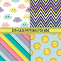 Set of colorful seamless pattern. Childish background with smiling suns and clouds. Holiday design. Vector illustration.