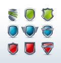 Set of colorful shiny metallic shield icons  illus Royalty Free Stock Image