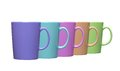 Set of colorful teacups on white
